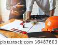Confident team of architect working together 36487603