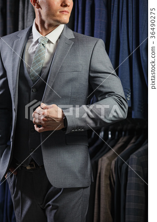 client is elegant guy in jacket. In the background 36490275