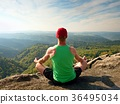 Slim body hiker in singlet and black shorts sit 36495034