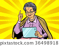 Caucasian elderly woman with a tablet 36498918