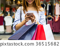 Young woman with shopping bags in the shop 36515682