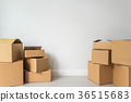 Stack of cardboard boxes in empty room 36515683