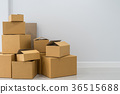 Stack of cardboard boxes in empty room 36515688