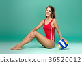 sports woman with volleyball 36520012