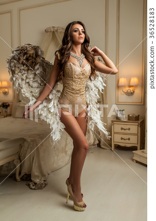 beautiful brunette woman stands with  wings 36528183