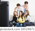 young group Sitting On Sofa Watching TV  show 36529671