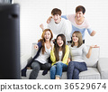 young group Sitting On Sofa Watching TV  show 36529674