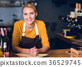 Cheerful girl having job in cafe 36529745