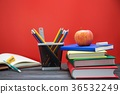School books many on desk. and Equipment along wit 36532249