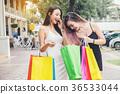 Happy Asian women friendship Enjoying shopping 36533044