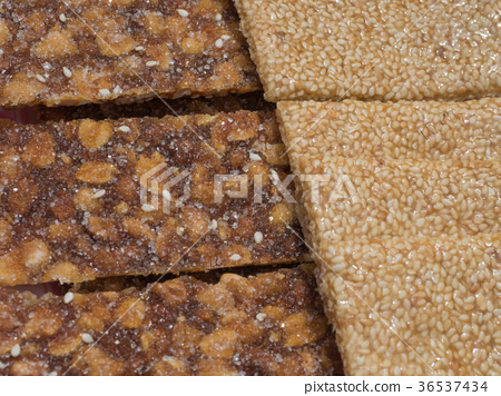 Sweet snack bar with peanuts and sesame seeds 36537434