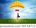 Businesswoman flying on parachute in business 36538712