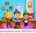 cute kids in the living room during christmas 36545575