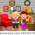 cute kids in the living room during christmas 36545579