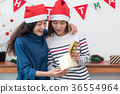 asia woman surprise when open gold gift box 36554964