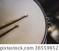 Drumsticks on a black background. 36559652