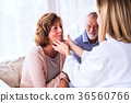 Female doctor examining a senior woman. 36560766