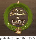 Christmas fir wreath on wooden background 36563529