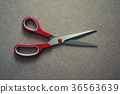 scisors with red plastic handle 36563639