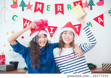 Two girl frind holding christmas gift and smile 36577550