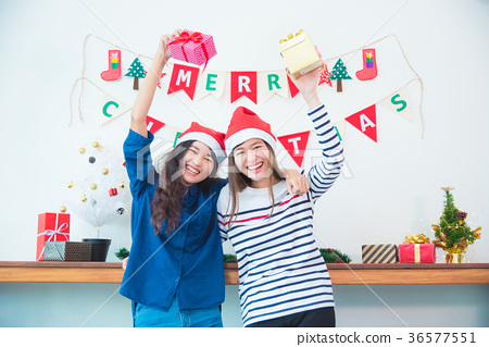 Two girl frind holding christmas gift and smile 36577551