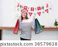 Happy Asia woman holding many shopping bag 36579638