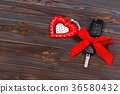 Car key with red heart on black natural background 36580432