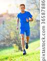 Professional mountain running athlete in training 36587886