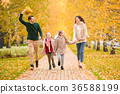 Beautiful happy family of four in autumn day 36588199