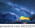Milky Way, yellow glowing tent and mountains 36591639