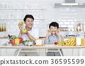 Young father with son preparing dishes, and dish washing together. 340 36595599