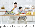 Young father with son preparing dishes, and dish washing together. 358 36595810