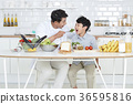 Young father with son preparing dishes, and dish washing together. 366 36595816
