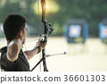 The archery has a goal to win. 36601303