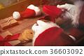 Santa Claus wrapping up Christmas gifts  36603092