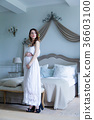 Young pregnant woman in white dress 36603100