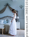 Young pregnant woman in white dress 36603101