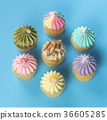 Fancy mini cupcakes top view on blue background 36605285