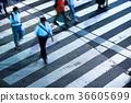 People crossing a pedestrian crossing 36605699