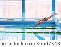 Senior man jumping in the swimming pool. 36607548