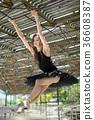 Ballerina posing outdoors 36608387