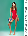 sports woman with volleyball 36609015