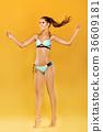 tanned woman in blue bikini 36609181