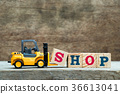 Yellow forklift hold letter S to complete shop 36613041
