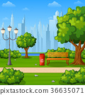 City park bench with trees and town buildings 36635071