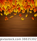 Wooden background with autumn leaves falling 36635302