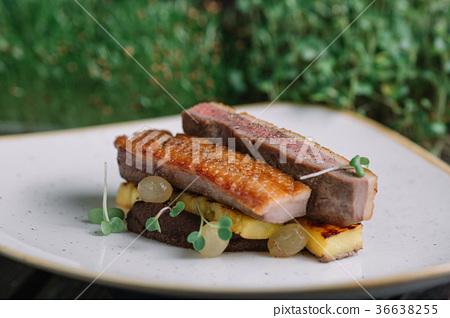 Duck fillet with polenta on irregular shape plate  36638255