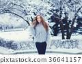 Fashion girl in winter snow park 36641157