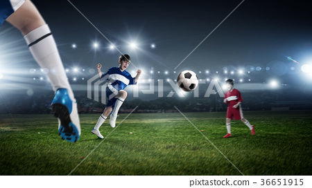 Kids play soccer on stadium 36651915