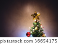 Christmas star on christmas tree with decorations 36654175